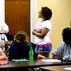 8-28-13  --  The Excel Center, a charter school, offering adult high school and college education. Teacher Gidget Fisher works with Ce'Asia Woodard to get a point across to the class. The other teacher for this class, Shannon Cowan, writes on the white board.<br />    KT photo | Tim Bath