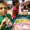 9-6-13  --  School lunchtime at Lafayette Park Elementary School. Ethan Burkhead a 3rd grader ate most of his food while Myah Sears(pink shirt) ate only her corn.<br />    KT photo | Tim Bath