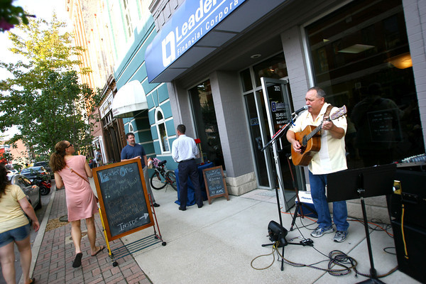 9-6-13  --  Eric Foust sings outside LeaderOne financial services on Norht Main Street during First Friday Downtown Sept 6.<br />    KT photo | Tim Bath