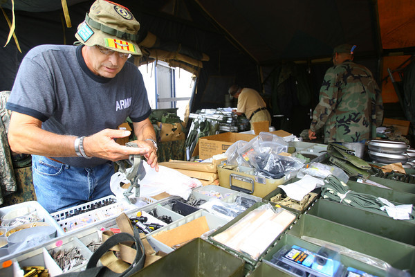 9-19-13  --  Annual Vietnam Veterans Reunion. Tim Olesak from North Hampton, Pennsylvania checks out some of the items available for sale at the reunion.<br />    KT photo | Tim Bath