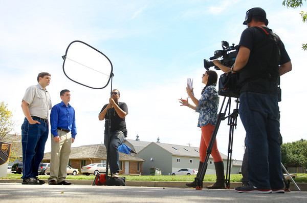 9-17-13  --  Steven Underwood with help from his cousin Jonathan Underwood participate in My First House a TV program for TLC. Realtor Gena Martin with the Hardie Group is the person showing Steve houses throughout Kokomo and helping him make a choice. <br />    KT photo | Tim Bath