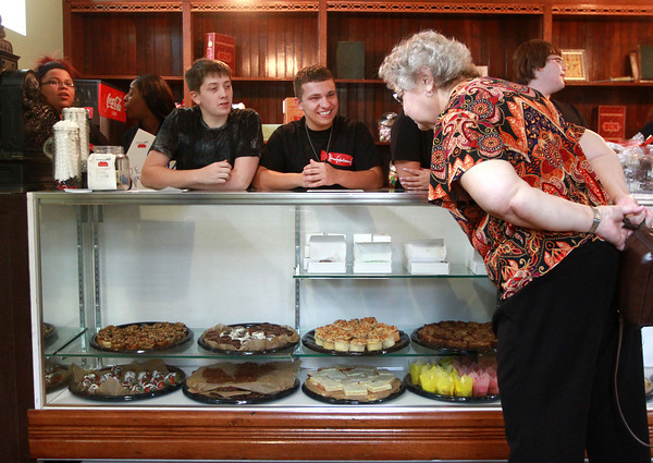 9-3-13<br /> Kokomo Confectionary<br /> Justin Haworth and Brock Earnheart listen as Kathy Kennedy makes her selection of sweets at Kokomo Confectioners Company.<br /> KT photo   Kelly Lafferty
