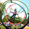 9-21-13<br /> Amboy Fall Festival<br /> 10-year-old Sierra Bakehorn spins on one of the rides at Amboy's fall festival.<br /> KT photo | Kelly Lafferty