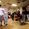 9-1-13<br /> Swampwater Stompers 20th Anniversary<br /> Larry and Donna Breedlove dance to the Swampwater Stompers.<br /> KT photo | Kelly Lafferty