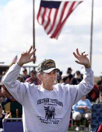 9-21-13<br /> Saturday's Vietnam Vet reunion<br /> Rich McCracken raises his arms while the Army song is played at the Vietnam Veteran reunion on Saturday. McCracken served in the Army from 1969-69<br /> KT photo | Kelly Lafferty