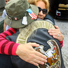 9-19-13  --  After addressing the crowd Teri Rose, mother of PFC Neil Simmons who died in 2007 in Iraq, gets hugs from veterans like Julius Torrentt during the annual Vietnam Veterans Reunion.<br />    KT photo | Tim Bath