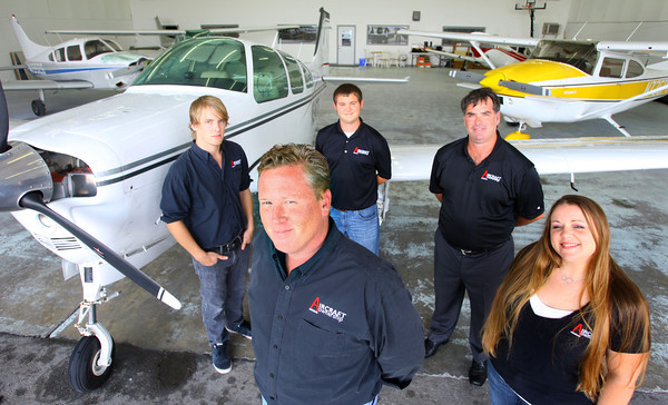 9-19-13  --  Aircraft Ownership Solutions operating out of Kokomo Airport. The specialize in reselling small airplanes. Owner Tim Keenan stands with some of his crew Garrett Henson, Dan Nicolosi, Jimmy Rezo and Sherri Thor in the hanger where they keep some of the planes for sale.<br />    KT photo | Tim Bath