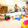8-28-13  --  The Excel Center, a charter school, offering adult high school and college education. One of the features offered is free child care. Kaylynn David and Oscar Vega-Mendoza play while Bailey Dickison holds Liliana Vega-Mendoza.<br />    KT photo | Tim Bath