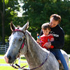 9-21-13<br /> Amboy Fall Festival<br /> Marie Adams and Corey Marden ride on a horse during Amboy's fall festival.<br /> KT photo | Kelly Lafferty