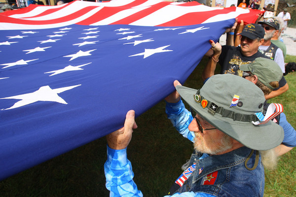 9-19-13  --  Annual Vietnam Veterans Reunion. Dave Walters of New Jersey holds the flag during the opening ceremonies.<br />    KT photo   Tim Bath