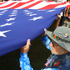 9-19-13  --  Annual Vietnam Veterans Reunion. Dave Walters of New Jersey holds the flag during the opening ceremonies.<br />    KT photo | Tim Bath