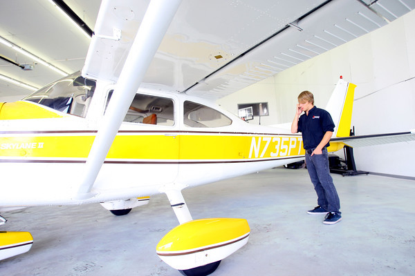 9-19-13  --  Aircraft Ownership Solutions operating out of Kokomo Airport. The specialize in reselling small airplanes. Garrett Henson stands next to one of the cessna aircraft while talking with a customer.<br />    KT photo | Tim Bath
