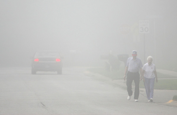 9-4-12<br /> Don and Kathryne Foust, married 65 years, walking along Santa Fe for their morning mile walk during the morning fog. County schools delayed. Eastern and Northwestern finally cancelled school.<br /> KT photo | Tim Bath