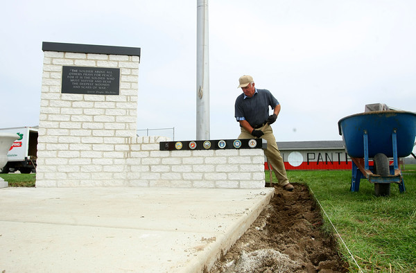 9-27-12 <br /> Brian Cossell from Cossell's Landscaping, digs out the area around the flag pole and new soldier's memorial that will be dedicated on Friday evening at Western HS football field.<br /> KT photo | Tim Bath