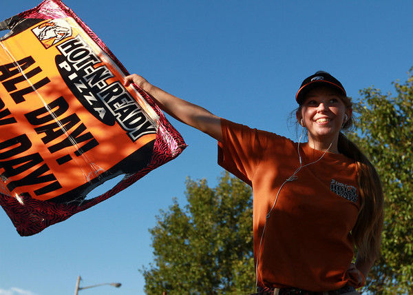 9-11-12<br /> Little Caesars Rebecca Vann<br /> Little Caesars shakerboarder Rebecca Vann smiles at the motorists that pass by the Little Caesars on Washington and Markland. Some of them honk which Vann says is motivational to her.<br /> KT photo | Kelly Lafferty
