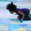 9-28-12<br /> Oktoberfest<br /> Brooklyn McKelvin, 10, blows chalk dust off her creation during Chalk the Block at Oktoberfest on Friday.<br /> KT photo | Kelly Lafferty