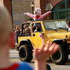 9-6-12<br /> Pork Fest<br /> A young parade-goer waves to Pork Boy, the Pork Festival mascot during the parade on Thursday.<br /> KT photo | Kelly Lafferty