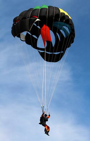9-15-12 <br /> Vietnam Vet Reunion Saturday<br /> A parachuter prepares to land on the Vietnam veteran reunion grounds on Saturday.<br /> KT photo | Kelly Lafferty