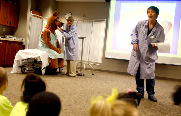 9-17-12 <br /> Lets Pretend Hospital at St. Joseph Hospital hosting kindergarten kids from all over the area. Sycamore Elementary School students watch Scooby Doo being treated after breaking his arm. Doc Marie Becker, with Scooby, and Nurse Alex Roberts guide the kids through the experience in the emergency room.<br /> KT photo   Tim Bath