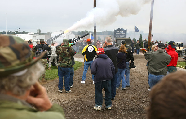 9-14-12<br /> Vietnam Veterans Reunion<br /> Ron Martin and his grandson Kyle McIntosh hold their ears while the big guns are fired off.<br /> KT photo | Tim Bath