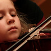 9-12-12<br /> Youth program strings instructional class<br /> 5-year-old Bethany Gray keeps her eyes on her bow to make sure it's on the right string during the first day of the fall semester of strings class at Grace United Methodist Church.<br /> KT photo | Kelly Lafferty
