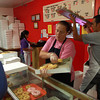 9-22-12<br /> Dan's Donuts at 1 AM<br /> Kathy Harris takes care of a customers order during a busy time for Dan's Donuts at 1 a.m. on Saturday morning. Harris has been working at Dan's Donuts for more than a year.<br /> KT photo | Kelly Lafferty