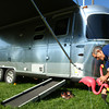9-12-12<br /> Airstream campers converging on Tipton County Fairgrounds. Brian McFaarland from Chicago sets up a few pink flamingoes outside his 2013 25 ft Airstream Flying Cloud.<br /> KT photo | Tim Bath