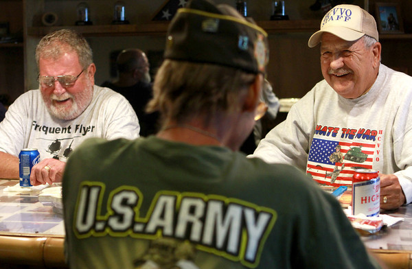 9-7-12<br /> Don Woolum of Cincinnati, left, and Jim Smith of Kokomo, right, laugh at a story fellow Vietnam veteran, Rick Daugherty, of Kokomo, center, was telling.  Woolum served in the Army, Smith in the Marine Corps, and Daugherty in the Army Rangers.<br /> KT photo | Kelly Lafferty
