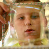 9-8-12<br /> Education Express<br /> 12-year-old K.J. Roudebush examines a bubble he created in a cube at IUK during Education Express on Saturday.<br /> KT photo | Kelly Lafferty