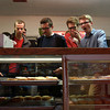 9-22-12<br /> Dan's Donuts at 1 AM<br /> From left: Indiana Wesleyan students Thomas Weimer, Colton Nelson, Joseph Tatum, William Bewley, and Ball State student Brandon Denman look over the many different varieties of donuts at Dan's Donuts to figure out which ones to get.<br /> KT photo | Kelly Lafferty