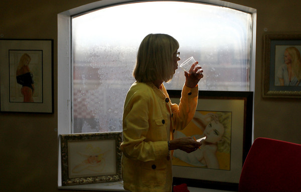 9-15-12 <br /> Kim Fipps Art Gallery<br /> Cathy Morrow sips her drink as she walks through the room displaying Kim Fipps artwork on Saturday.<br /> KT photo | Kelly Lafferty