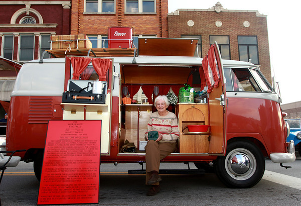 """9-28-12<br /> Oktoberfest<br /> 95-year-old Lenore Costello sits inside her Volkswagen Westfalia Camper that she and her husband bought in 1960 when they traveled to Germany. The Camper's name is """"George.""""<br /> KT photo 