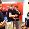 9-21-12 <br /> The new iPhone 5 was released with lines at the Verizon Store in Southway Plaza. Cody Shrout gets a little help setting up the final connections from SanToya Tyler at the store.<br /> KT photo | Tim Bath