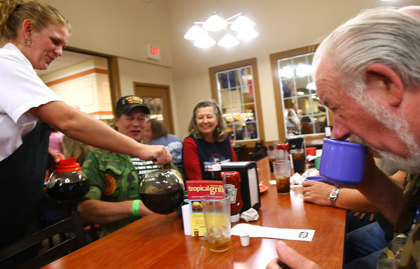 9-14-12<br /> Vietnam Veterans brought lots of money to Howard County. One popular spot to eat is the Golden Corral. Jessica Roberts serves coffee to Chris Peterkin, Mary Lou Peterkin, Dick Langhans, Joe Luntke, Jim Luntke and Bruce Burnham at the Golden Corral.<br /> KT photo | Tim Bath