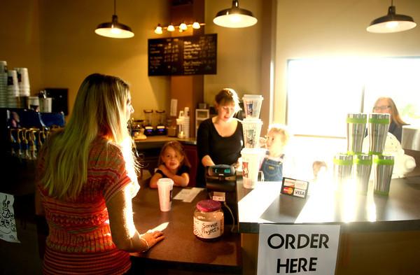 9-16-12 <br /> Crossroads Community Church Sunday morning breakfast<br /> Leslie Raab getting her morning coffee from Ashley Ausbrook at the coffee shop.<br /> KT photo | Tim Bath