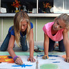 9-28-12<br /> Oktoberfest<br /> 9-year-old Nicole Burdette (left) and 8-year-old Molly Dowden (right) work side-by-side as they finish creating their art for Chalk the Block at Oktoberfest on Friday.<br /> KT photo | Kelly Lafferty