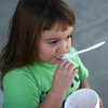 9-20-12<br /> Berrywinkle<br /> Bethany Baker, 3, scrapes the last of her strawberry frozen yogurt out of her cup outside of Berrywinkle on Thursday.<br /> KT photo | Kelly Lafferty