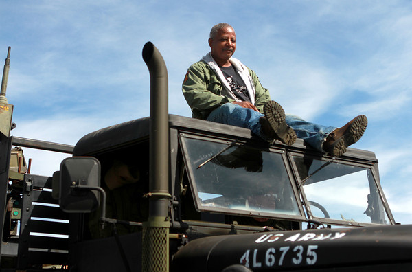 9-15-12 <br /> Vietnam Vet Reunion Saturday<br /> Jesse Vaughn of Jacksonville, Fla. sits on the top of the U.S. Army vehicle during Saturday's Vietnam veteran reunion. Vaughn served with the Army in 1968.<br /> KT photo | Kelly Lafferty