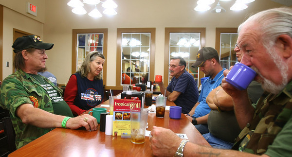 9-14-12<br /> Vietnam Veterans brought lots of money to Howard County. One popular spot to eat is the Golden Corral. Chris Peterkin, Mary Lou Peterkin, Dick Langhans, Joe Luntke, Jim Luntke and Bruce Burnham having coffee after dinner at the Golden Corral.<br /> KT photo | Tim Bath