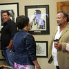 9-15-12 <br /> Kim Fipps Art Gallery<br /> Kim Fipps (second from right) talks to guests during his art show at Artworks on Saturday evening.<br /> KT photo | Kelly Lafferty
