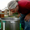 9-20-12<br /> Homebrewing at the library<br /> Dave Johnson smells the batch of brewing beer after hops had been added to it during the demonstration of homebrewing at the library.<br /> KT photo | Kelly Lafferty