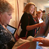 9-18-12<br /> United Way dinner<br /> Cheryl Sullivan (center) and Jeanne Stier (left) receive United Way t-shirts as parting gifts from the United Way dinner at Rozzi's on Tuesday evening.<br /> KT photo | Kelly Lafferty