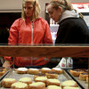 9-22-12<br /> Dan's Donuts at 1 AM<br /> Becca Ebenhoch (left) and Kelly Friske decide on the donuts they want to get at Dan's Donuts early Saturday morning.<br /> KT photo | Kelly Lafferty