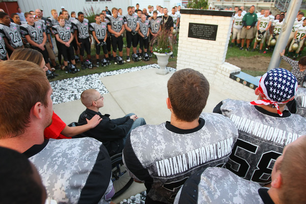 9-28-12 <br /> Before the Western HS vs. Eastern HS football game both teams gathered around the monument at Western's football field to honor veterans.<br /> KT photo | Tim Bath