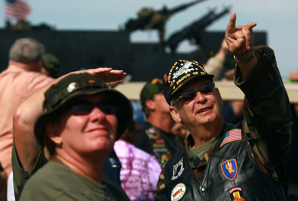 9-15-12 <br /> Vietnam Vet Reunion Saturday<br /> Don Davidson (right) points to the sky where he spotted one of the parachuters who jumped from the plane. Davidson, from Austin, Ind. served in the Army in 1967-68.<br /> KT photo   Kelly Lafferty