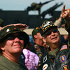 9-15-12 <br /> Vietnam Vet Reunion Saturday<br /> Don Davidson (right) points to the sky where he spotted one of the parachuters who jumped from the plane. Davidson, from Austin, Ind. served in the Army in 1967-68.<br /> KT photo | Kelly Lafferty