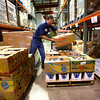 9-27-12 <br /> Food Finders located in Lafayette, supplies food to distribution sites in 16 counties including Howard and Miami Counties. Urban Outreach, Salvation Army, and Rescue Mission are some of those organizations. Ryan Bresnahan pulls items to be shipped to an off site location for distribution through the Backpack Program.<br /> KT photo | Tim Bath
