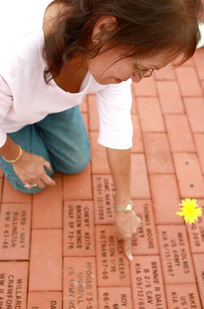 9-13-12<br /> Vietnam Vet Reunion<br /> Lillie Dale points to her brother's name on the brick. Her brother Bennie Dale was killed in action on May 12, 1968. <br /> KT photo | Kelly Lafferty