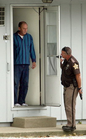 9-21-12 <br /> Howard County Deputies surrounded an apartment at 247 N. Union Street in Russiaville on Friday after reports came in of a woman being confined. The man was taken into custody and woman to the hospital for a high blood alcohol content.<br /> KT photo   Tim Bath