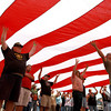 9-13-12<br /> Vietnam Vet Reunion<br /> People gather to help unfold and carry the flag during the opening cremonies of the Vietnam veteran reunion on Thursday.<br /> KT photo | Kelly Lafferty